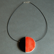 orange eclipse necklace