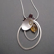 Oval and leaf pendant