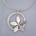 flower in circle pendant