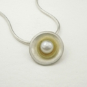 Silver and 18ct yellow gold double cup pendant with fresh water pearl