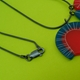 catch detail red and blue pendant
