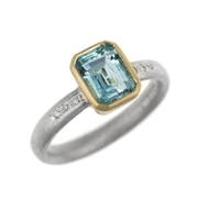 Emerald cut aquamarine, silver, diamond and 18ct yellow gold ring