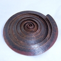 Spiral copper brooch