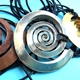 Small spiral pendants- copper,silver&brass