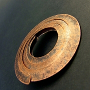 Small copper circle brooch