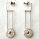 Rivet kinetic drop earrings
