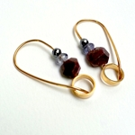 Gold hoops with rough rubies by Clara Breen