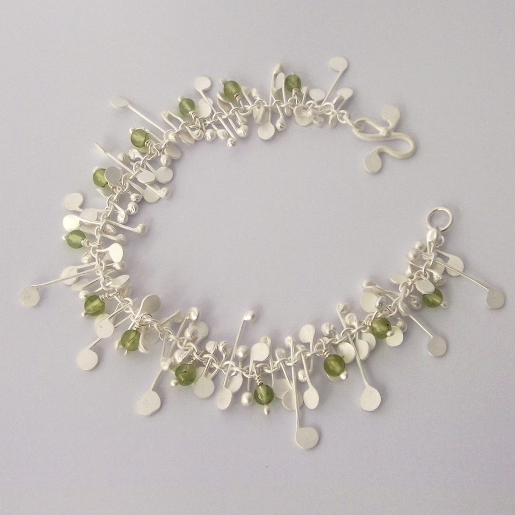Blossom wire bracelet with peridot, satin | Contemporary Bracelets ...
