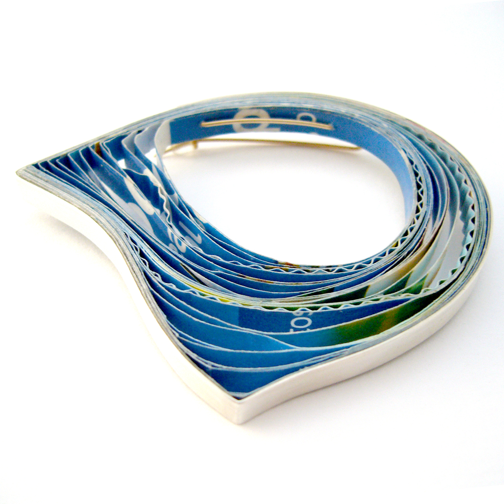 Blue paper and silver brooch