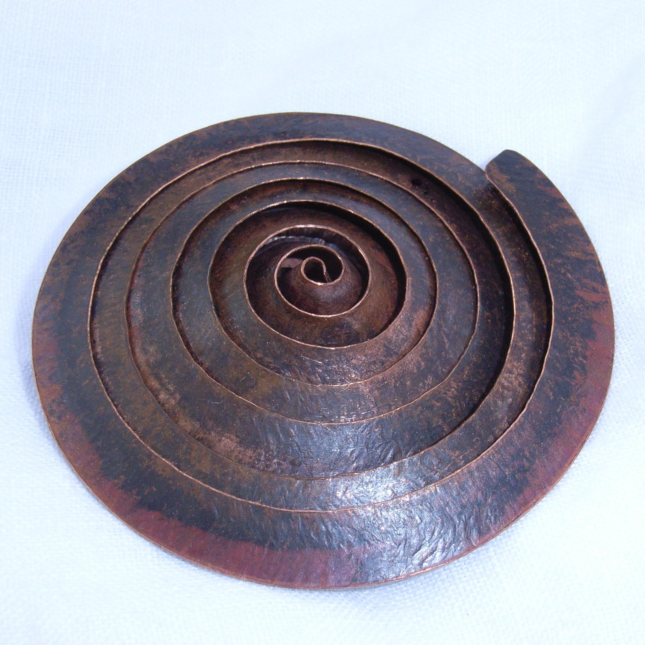 Spiral copper brooch