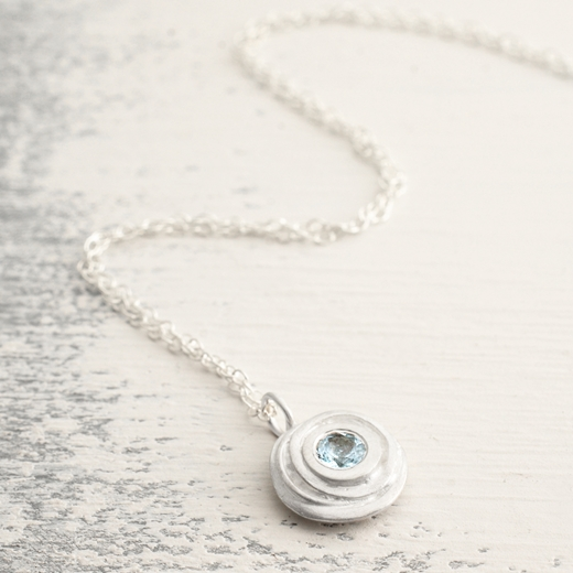 Silver and aquamarine small swirl necklace