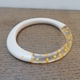 Nude wangle bangle with yellow dots