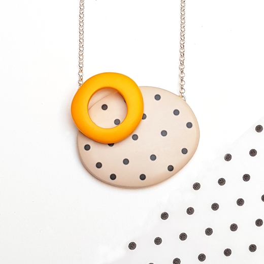 Double oval pendant - nude with black dots and yellow hoop.