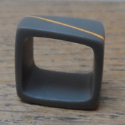 Charcoal square ring with orange diagonal stripe