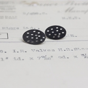 black holey oval studs