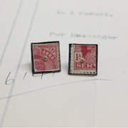 red stamp studs