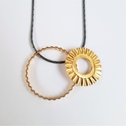 Sunray pendant in silver with gold plating by Clara Breen