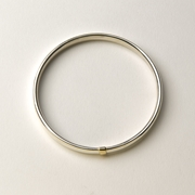 Heavy oval section gold stripe bangle