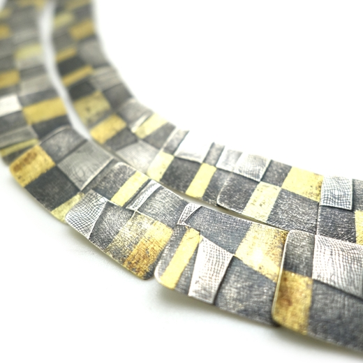 Seamed stripe necklace detail