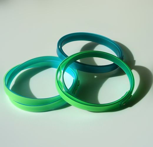 group showing thin lime green bangle and two other bangles