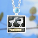 Birds of a feather pendant with topaz by Alan Ardiff