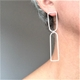Two wire arch earrings on the ear