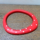 Red wangle bangle with nude spots