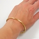 wrap bangle gold worn