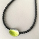 Part Yellow green perforated oval necklace
